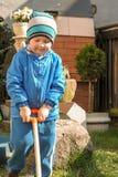 Boy shoveling Stock Images