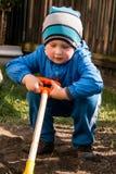 Boy shoveling Royalty Free Stock Photos