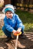 Boy shoveling Stock Photo