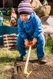 Boy shoveling Stock Image