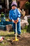 Boy shoveling Royalty Free Stock Images