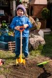 Boy shoveling Stock Photography