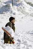 Boy shoveling snow. Young boy shoveling snow after sever winter storm Royalty Free Stock Image