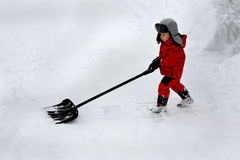 Boy shoveling snow Stock Photo