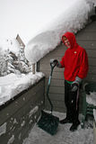 Boy shovelling snow Royalty Free Stock Image