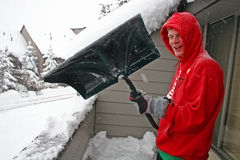 Boy shovelling snow Stock Images