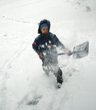 Boy shovels snow Stock Images