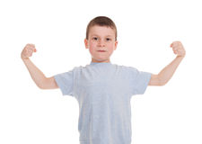 Boy show biceps Royalty Free Stock Image