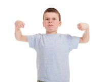 Boy show biceps Royalty Free Stock Photography