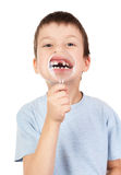Boy show lost tooth through magnifying glass Stock Photography
