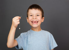 Boy show lost tooth on thread Stock Images
