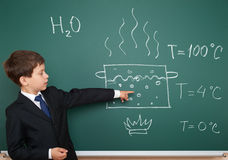 Boy show physical phenomenon hot water on board Stock Photography