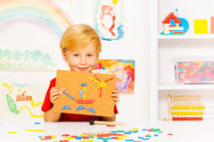Boy show picture made with nails and blocks Royalty Free Stock Photography