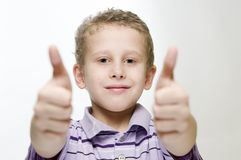Boy show two thumbs up wide Stock Image