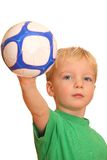 Boy showing a ball Royalty Free Stock Photo