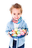 Boy showing an basket with colorful Easter eggs Stock Photo