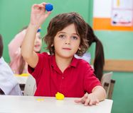 Boy Showing Clay In Classroom Stock Photography