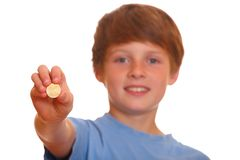 Boy showing a coin Stock Images