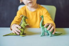 Boy showing a dinosaur as a paleontologist.  stock photography