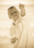 Boy showing finger beach Royalty Free Stock Images