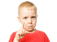 The boy showing forefinger gesture. Portrait of boy showing forefinger gesture, isolated over white background Stock Photo