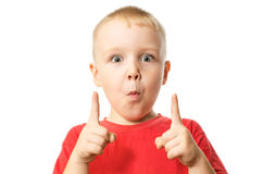 The boy showing forefingers gesture. Portrait of boy showing forefingers gesture, isolated over white background Royalty Free Stock Photo