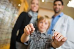Boy Showing Glasses With Mother And Optician In Royalty Free Stock Photography