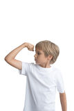 Boy showing his hand biceps muscles strength, isolated on white background. Stock Images