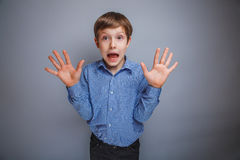 Boy showing his hands gasped emotions Royalty Free Stock Photo