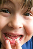 Boy showing his missing tooth Royalty Free Stock Images