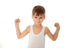 Boy showing his muscle. On white background Stock Photo