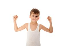 Boy showing his muscle. On white background Royalty Free Stock Photos