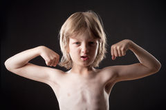 Boy Showing his Muscles Royalty Free Stock Photography