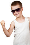 Boy showing his muscles isolated on white Royalty Free Stock Image