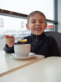 Boy showing his teeth Stock Photography