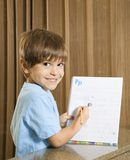 Boy showing homework. Royalty Free Stock Photography