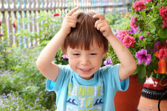 Boy showing horns Royalty Free Stock Images
