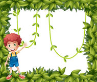 A boy showing the leafy frame with vine plants Stock Photos