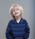 Boy showing missing milk teeth. Portrait of a boy with glasses showing his first missing milk teeth Stock Photos