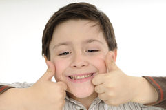 Boy showing ok sign. Cute school boy smiling in studio Royalty Free Stock Photo