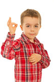 Boy showing okay sign hand gesture. Little boy showing okay sign hand gesture isolated on white background Royalty Free Stock Photo