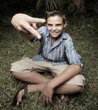 Boy showing a peace sign Stock Images