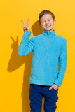 Boy showing peace sign Royalty Free Stock Photos