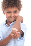 Boy showing plaster Royalty Free Stock Photography
