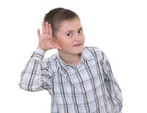 Boy showing he's listening Royalty Free Stock Image