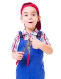 Boy showing shear cutting scissors hazard. Cute little handyman drawing attention on shear cutting scissors hazard of cutting finger stock photo