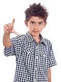 Boy showing the size Royalty Free Stock Photo