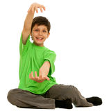 Boy showing the size of present he wants to get Royalty Free Stock Photography