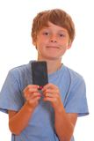 Boy showing a smartphone Royalty Free Stock Photos