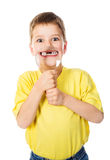 Boy showing teeth through a magnifying glass Royalty Free Stock Image